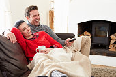 istock Couple Relaxing At Home Watching Television 502222089