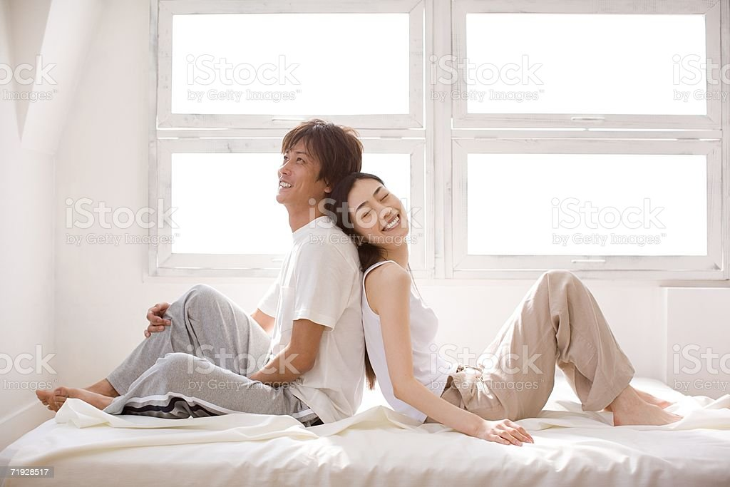 Couple relaxing back to back royalty-free stock photo