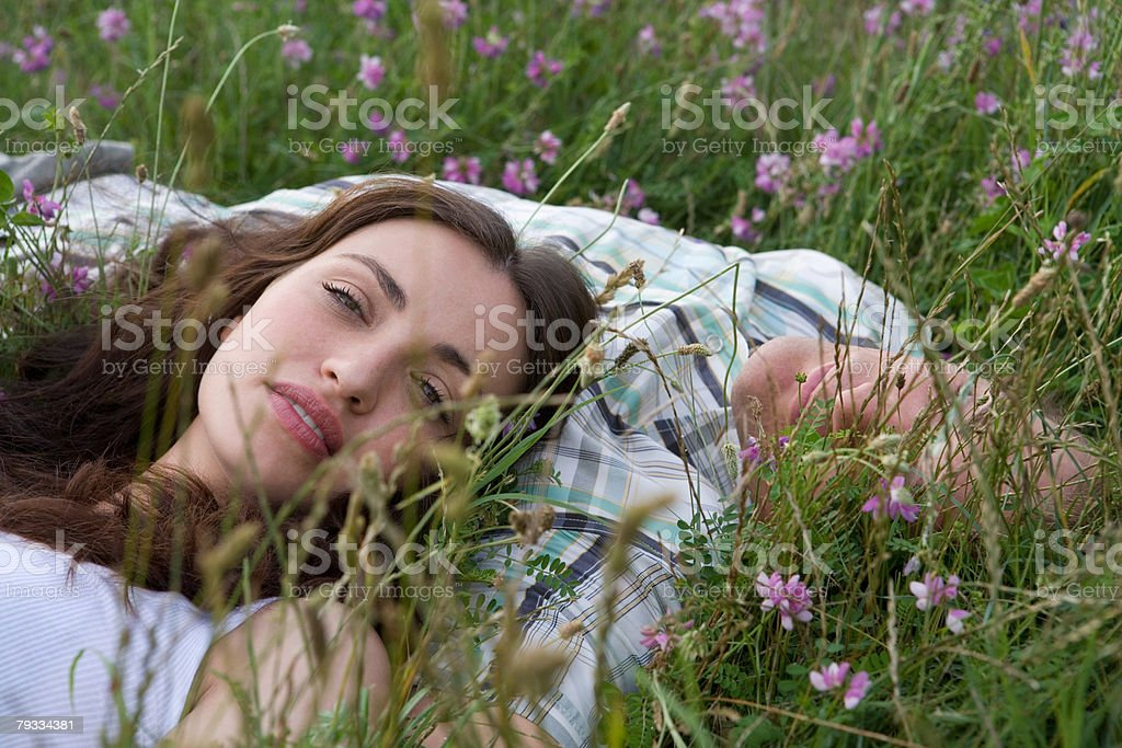 Couple relaxing in a field royalty-free stock photo