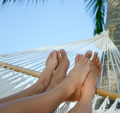 couple relaxing in a hammock on beach in the Caribbean