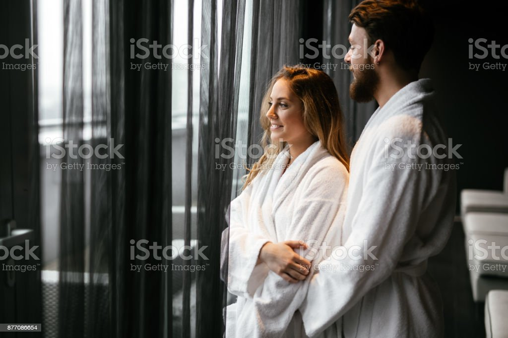 Couple relaxing in bathrobe stock photo