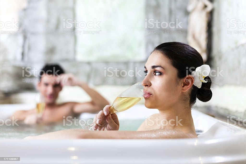 Couple relaxing in jacuzzi at health spa royalty-free stock photo