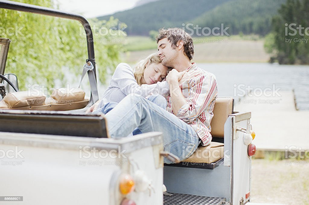 Couple relaxing in jeep 免版稅 stock photo