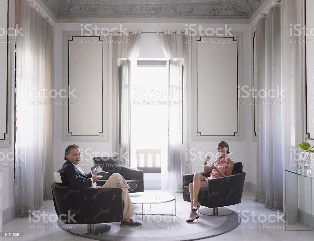 Couple relaxing in modern hotel suite royalty-free stock photo