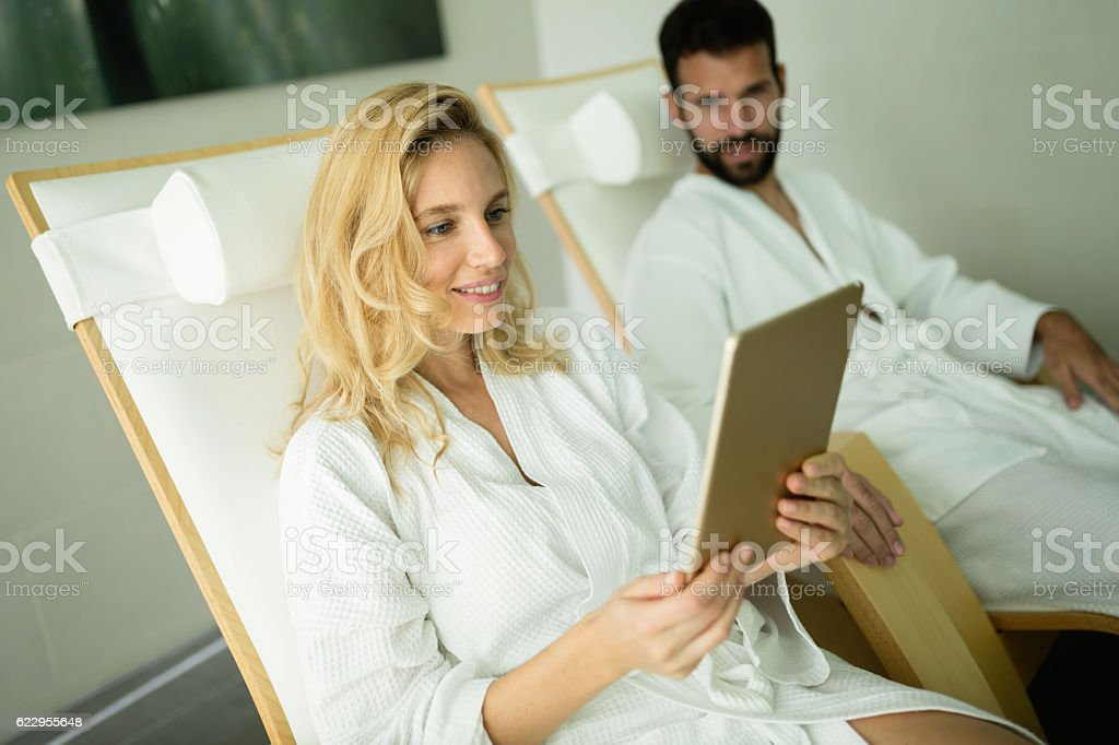 Couple relaxing in spa center stock photo