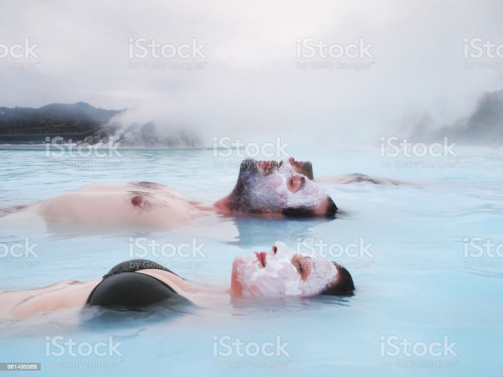 Couple Relaxing in the Blue Lagoon in Iceland stock photo
