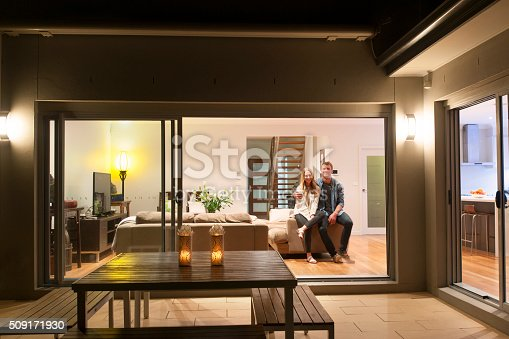 844050630 istock photo Couple relaxing in their home at night. 509171930