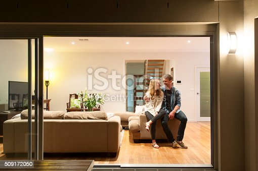 istock Couple relaxing in their home at night. 509172050