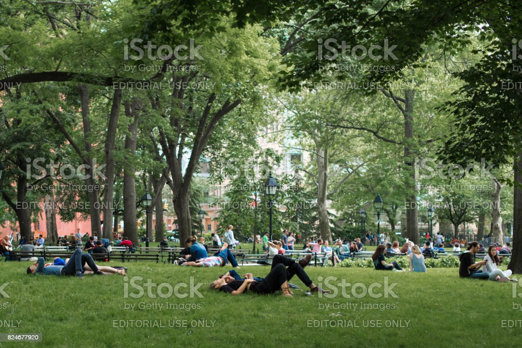 A couple relaxing in Washington Square Park stock photo