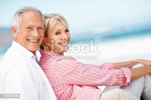 452783143 istock photo Couple relaxing on beach 154955180