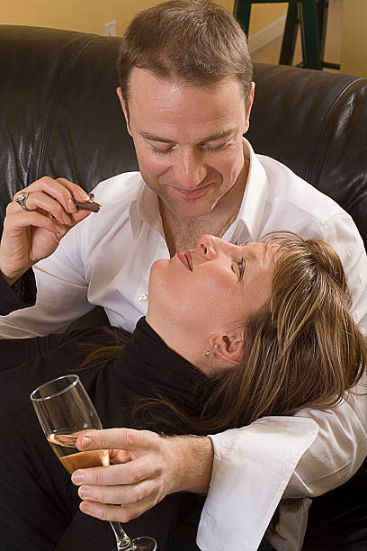 couple relaxing on couch stock photo