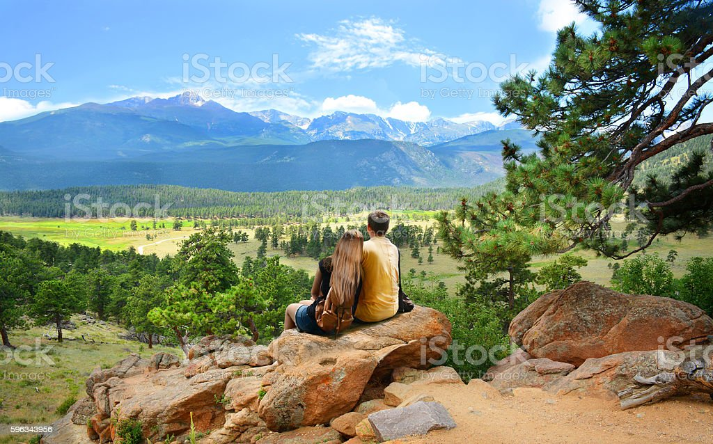 Couple relaxing on hiking trip looking at beautiful view. royalty-free stock photo