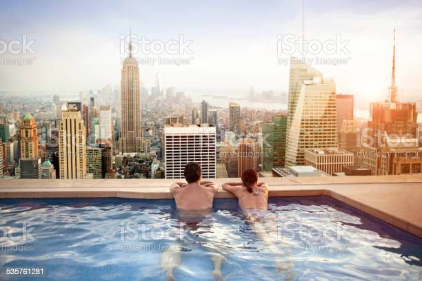 Couple relaxing on hotel rooftop picture id535761281?b=1&k=6&m=535761281&s=612x612&h=k3itrwur5spy5pysopdb4xhvdhxbrjkj0dpdfsvmyjc=