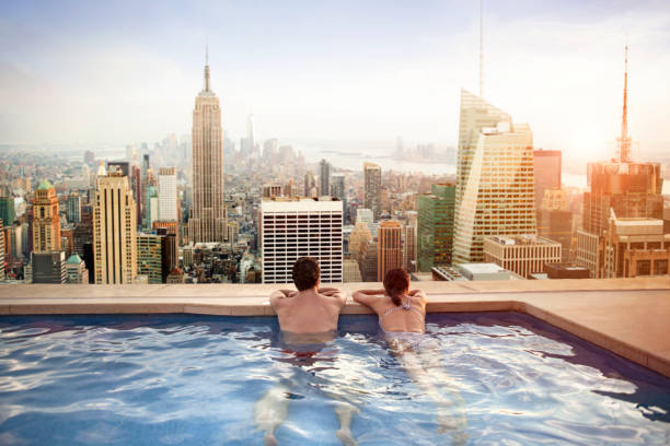 Couple relaxing on hotel rooftop stock photo