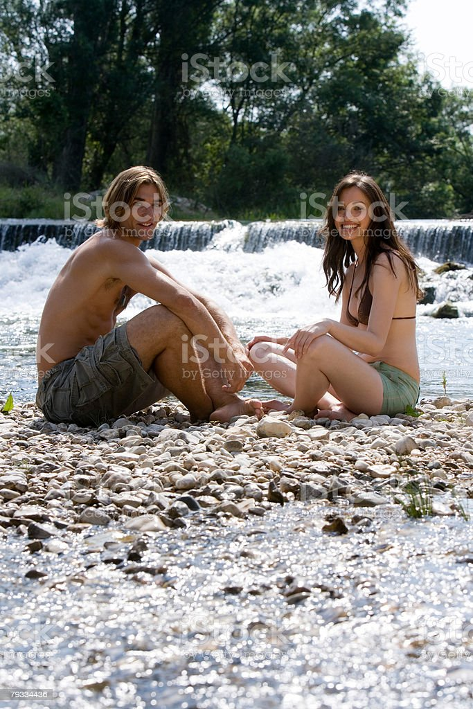 Couple relaxing on rocks 免版稅 stock photo