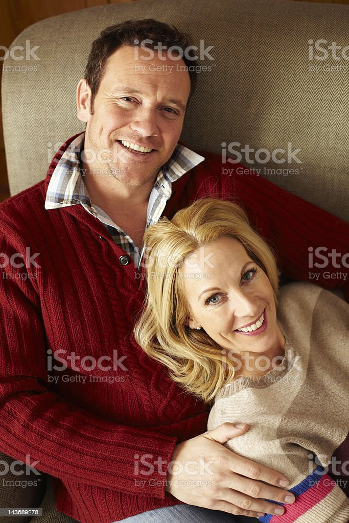 Couple relaxing on sofa together royalty-free stock photo