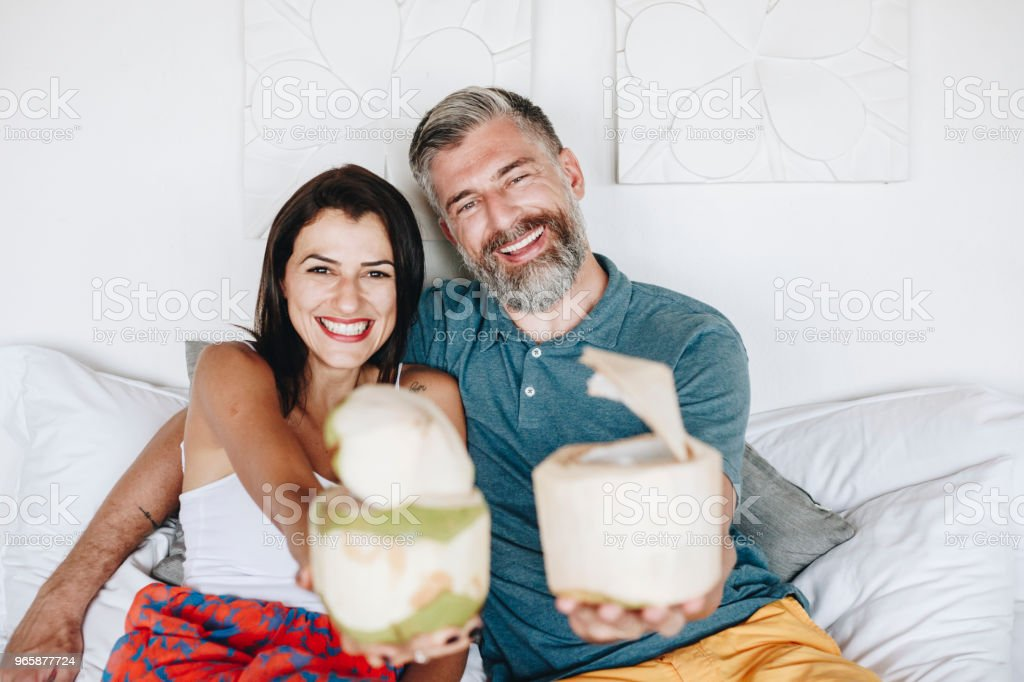 Couple relaxing on the bed - Royalty-free Adult Stock Photo