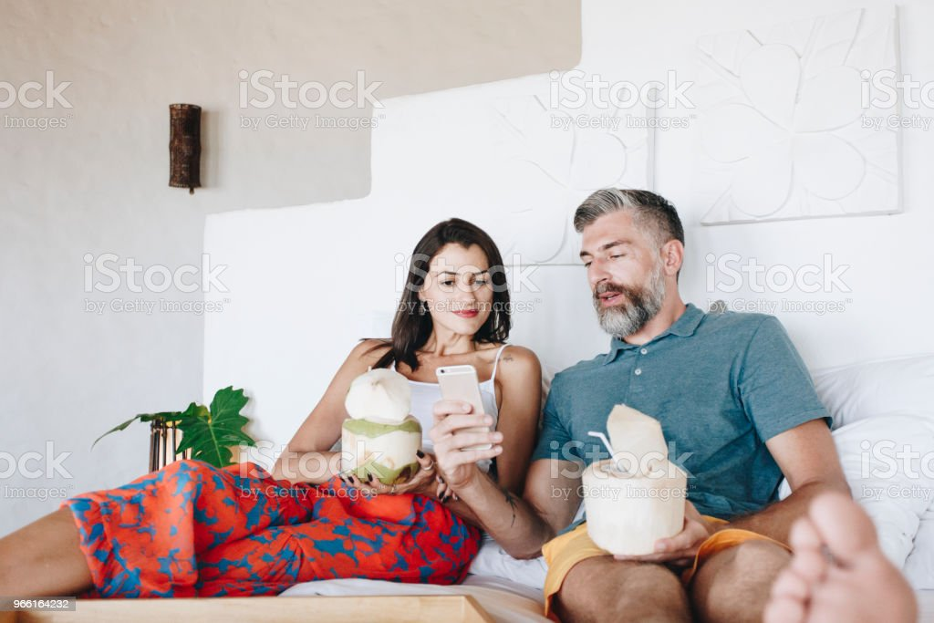 Couple relaxing on the bed - Foto stock royalty-free di Adulto