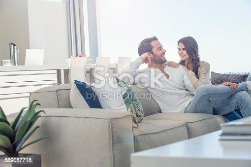 istock Couple relaxing on the sofa. 589087718