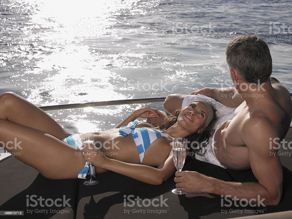 Couple Relaxing On Yacht's Edge stock photo
