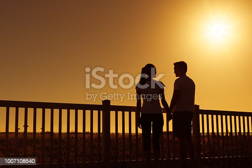 istock Couple relaxing outdoors 1007108540