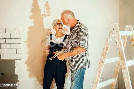 1063725014 istock photo Couple remodeling their home 1049241626