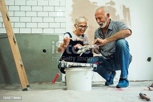 1063725014 istock photo Couple remodeling their home 1049778580