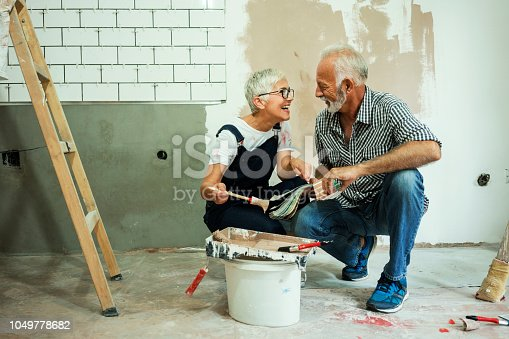 1063725014 istock photo Couple remodeling their home 1049778682