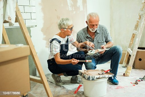 1063725014 istock photo Couple remodeling their home 1049778686