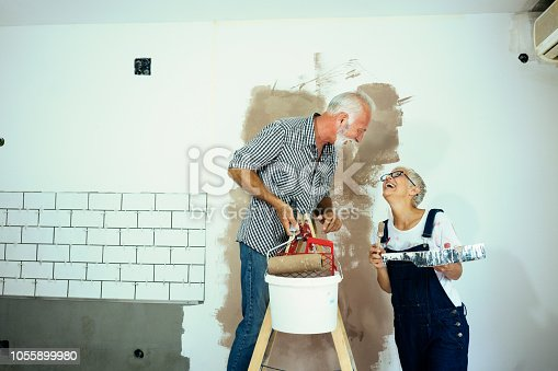 1063725014 istock photo Couple remodeling their home 1055899980