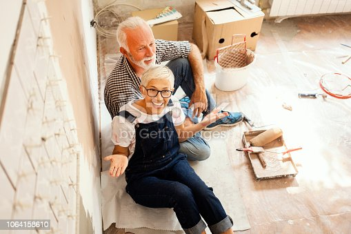 1063725014 istock photo Couple remodeling their home 1064158610