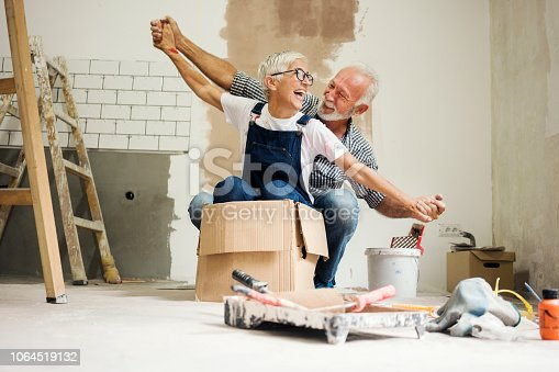 1063725014 istock photo Couple remodeling their home 1064519132