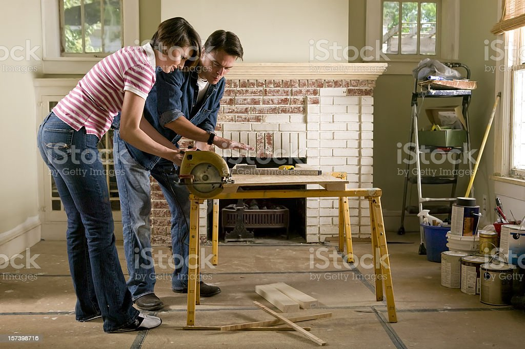 Couple renovating a home interior stock photo