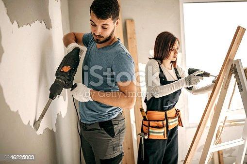 891274328 istock photo Couple renovating apartment 1146225003