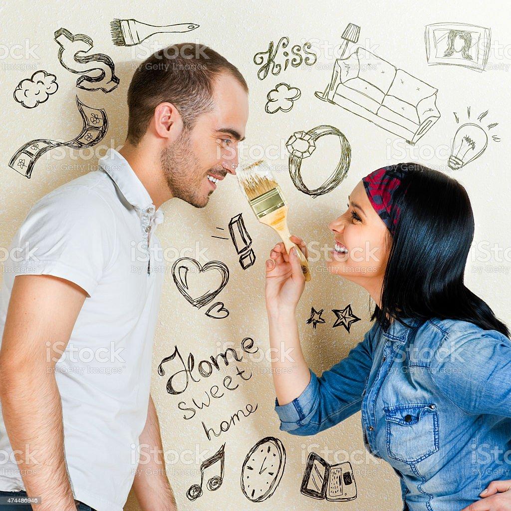 Couple renovating apartment stock photo