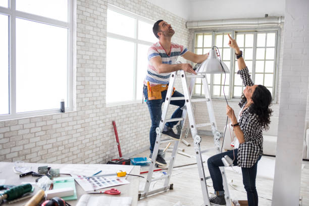 couple renovating their apartment - council flat stock photos and pictures