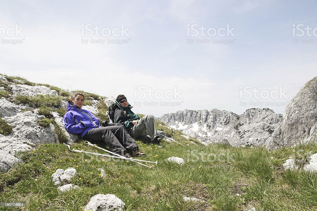 Couple resting during ascent royalty-free stock photo