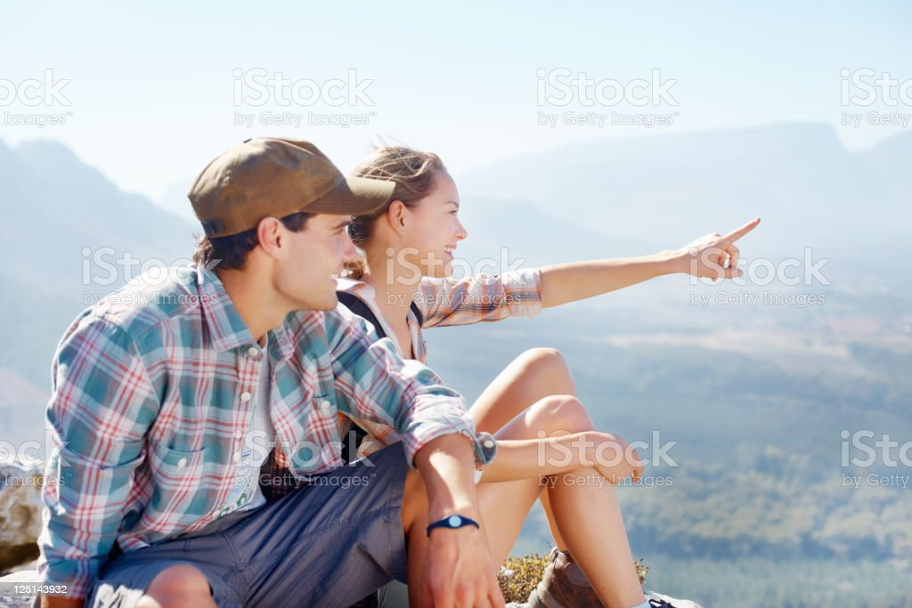 Couple resting from hiking royalty-free stock photo