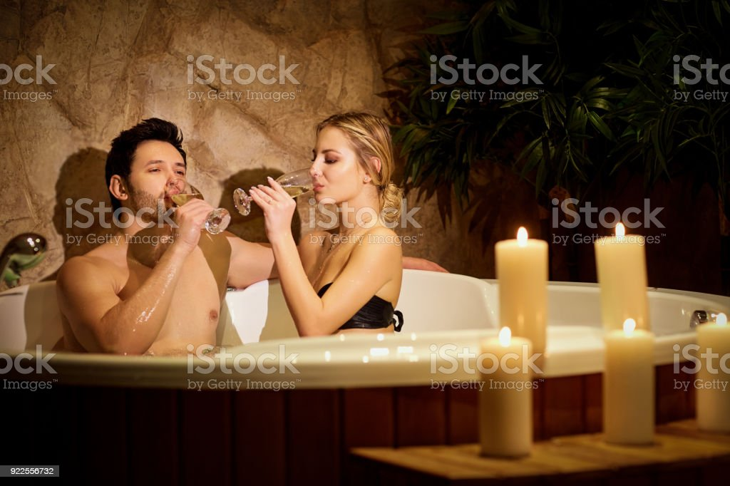 Couple Resting In Bath Tub With Candles In Spa Center Stock Photo ...