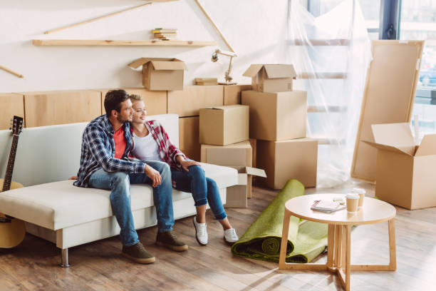 couple resting in new house - relocation stock photos and pictures