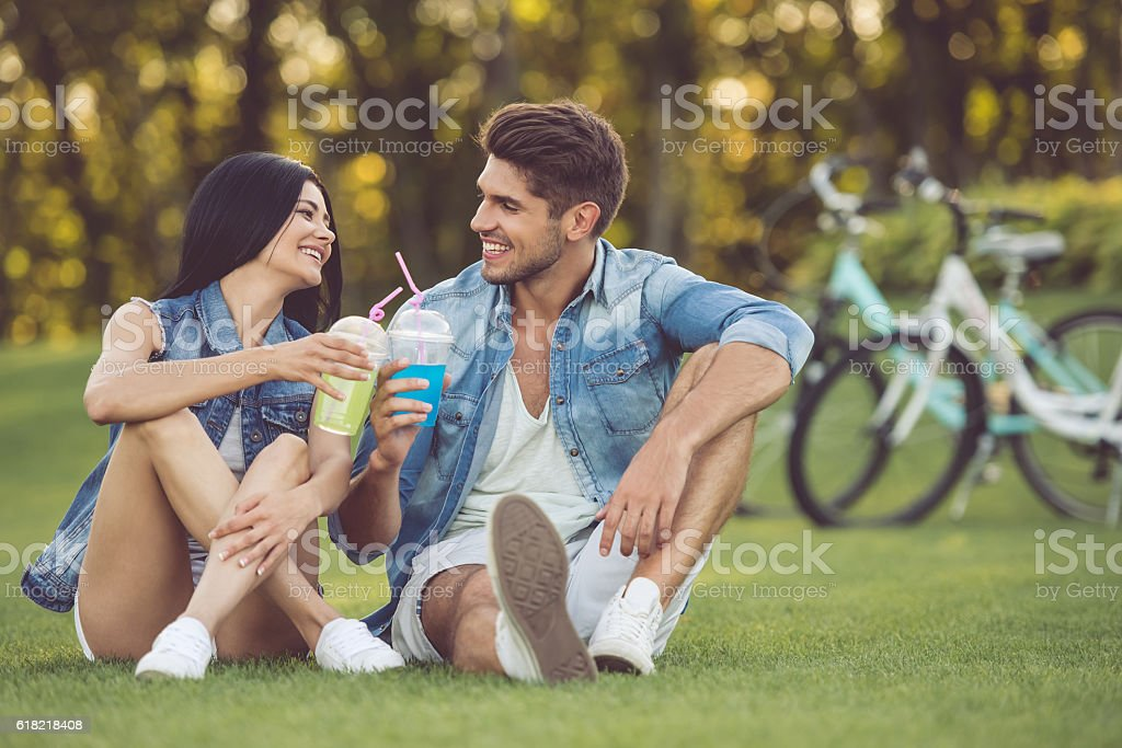 Couple resting in park stock photo
