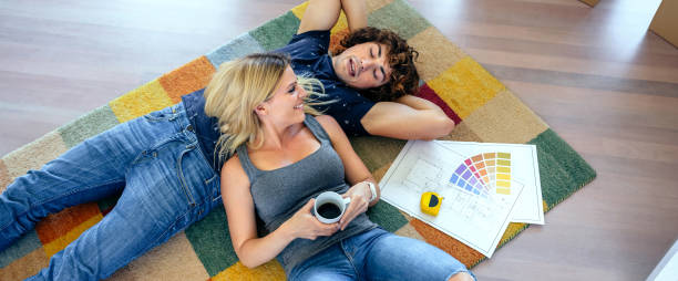 Couple resting lying on the carpet picture id1214733152?b=1&k=6&m=1214733152&s=612x612&w=0&h=lmg0zf0ta p0wtkzgjg akugppa0i0 xk69rbqual5w=