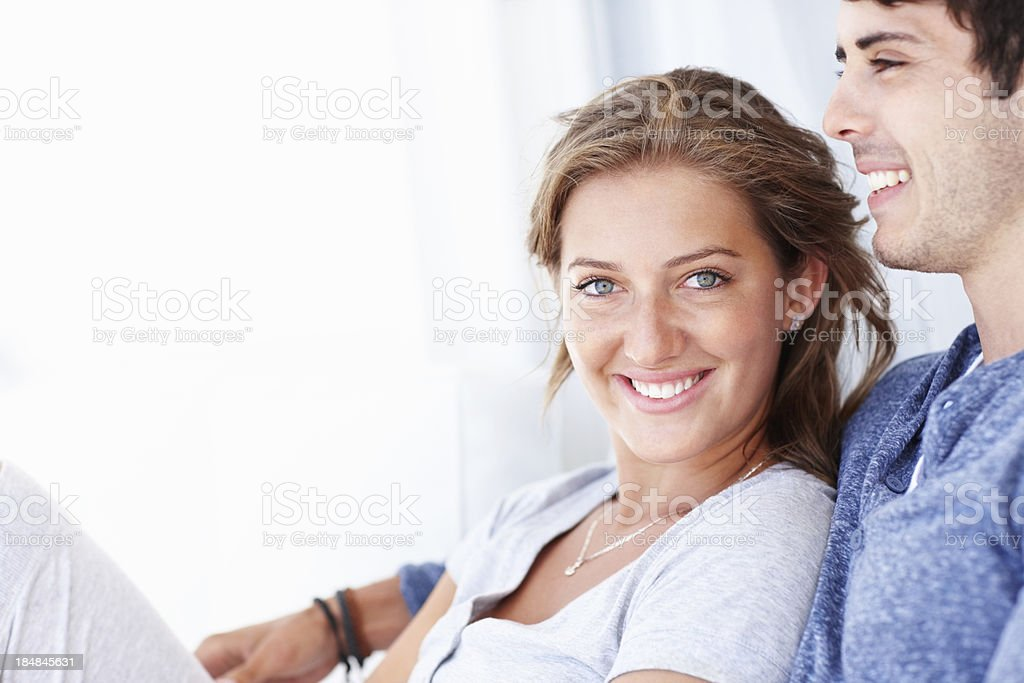 Couple resting on couch together royalty-free stock photo