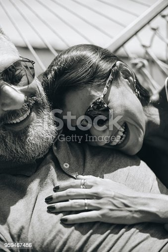 istock Couple resting together in a hammock 959467486