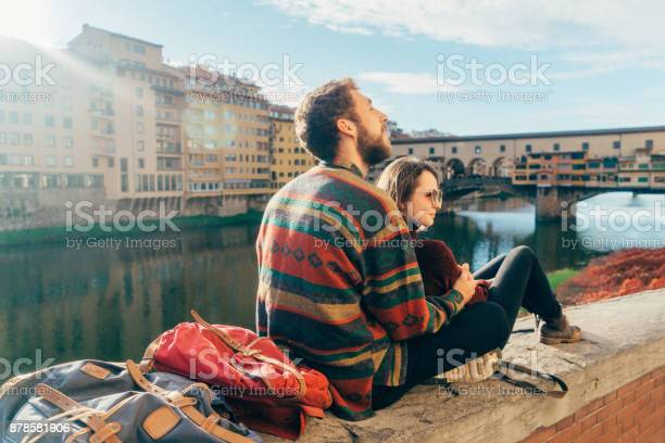 Couple resting with view on ponte vecchio of florence italy picture id878581906?b=1&k=6&m=878581906&s=612x612&h=ttqy4zba7yv5ct6gqgziov594iznnuxwl0z7w3d9tsg=