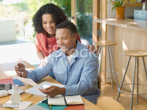 istock Couple reviewing paperwork at home 88583458