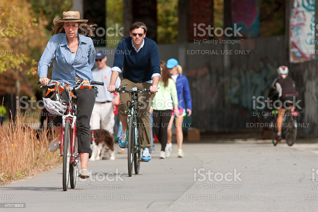 Couple Rides Bikes Along Urban Development Trail In Atlanta stock photo