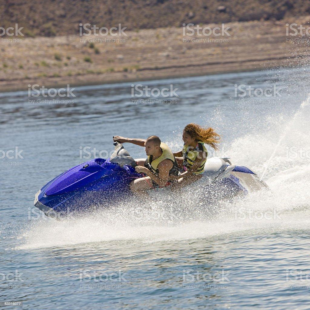 Couple rides jet ski foto stock royalty-free