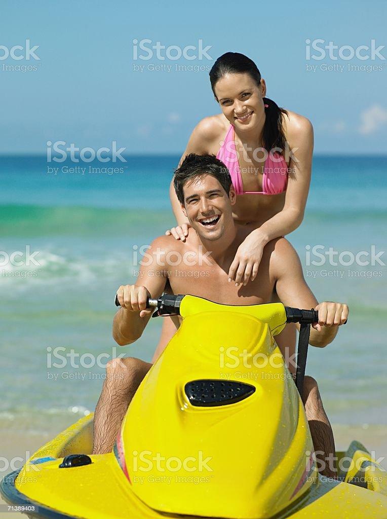 Couple riding a jet ski royalty-free stock photo
