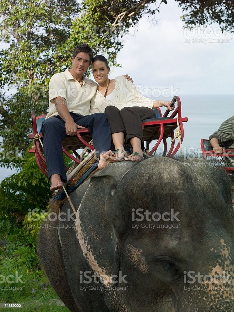 Couple riding an elephant royalty-free stock photo